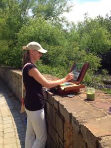 Anna painting en plein air